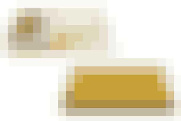 1. Sengetæppe med dip dye-effekt, 2.000 kr. (House Doctor)  2. Karrygul plaid, Moss, 499 kr. (Ilva)