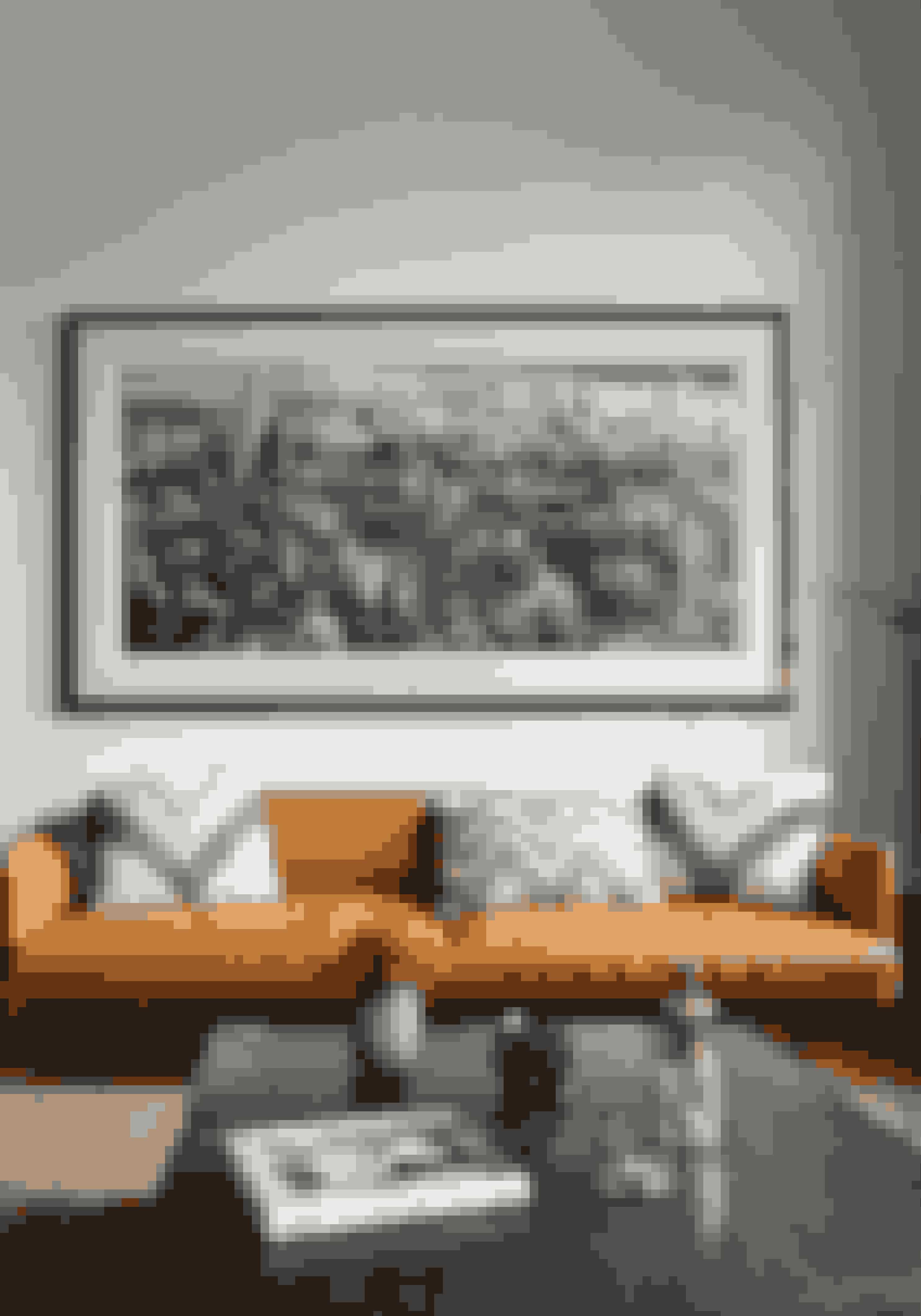 Kombinér klassisk design med rustikke møbler og industrielle detajler, og skab en stue med kant.