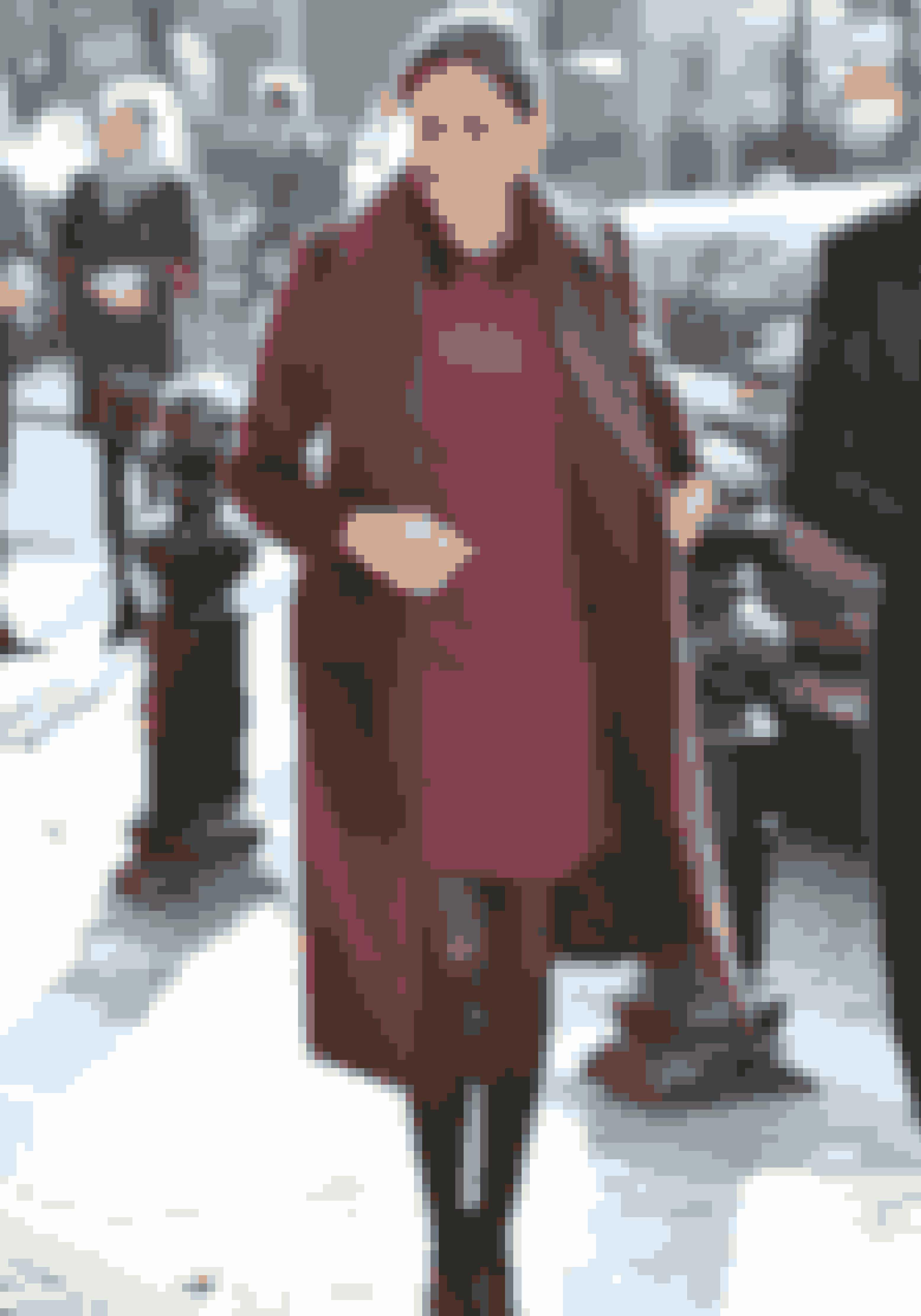 Meghan i frakke fra Club Monaco.